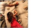 Girl climbing a Digiwall